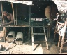 Leo Rubinfien / A Cambodian Refugee in His Hut, Site 8, from the portfolio Map of the East / 1979-1987
