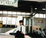 Leo Rubinfien / A Young Man Waiting for aTrain, Shibuya Station, Tokyo, from the portfolio Map of the East / 1979-1987