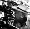 Todd Webb / Mr. Flaherty checks scene at Avery Island / July 1947