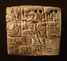 Mesopotamian / Administrative tablet with cylinder seal impression of a male figure, hunting dogs, and boars / 3100-2900 B.C.