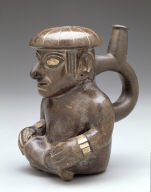 Stirrup-spout vessel depicting a seated man