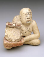 Seated hunchback holding mirror