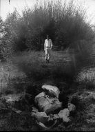 Man Walking in Woods