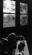Figure Lying Underneath Window