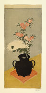 White chrysanthemums and pinks in a black vase