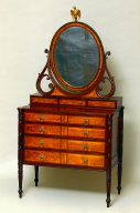 Chest of drawers with oval dressing mirror