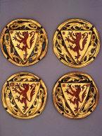 Four heraldic roundels