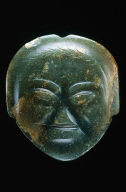 Pendant with human face