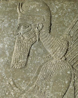 Relief of a winged genie holding bucket and cone