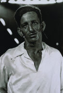 The human pincushion at a carnival in his silk shirt, N.J., 1961