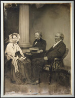 Two Seated Men and a Seated Woman