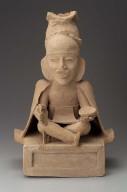 Seated human effigy