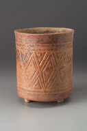 Tripod vase with incised geometric textile motifs