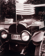 Automobile with American flags