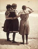 three women bathers at the shore