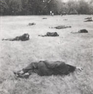 Untitled (men lying in field)