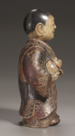 Standing Doll Clasping a Dog
