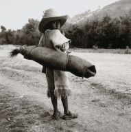 On the Road to San Juan Chamula, Chamula Boy Carrying Burlap Bag of Pine Boughs for a Ceremony (Tzotzil)