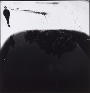 Untitled [figure in partially empty swimming pool]