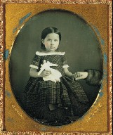 Girl with doll, holding mother's hand.