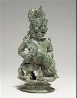 Top of a bell in the form of a demon king or guardian