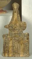 Seated Archaic Figurine