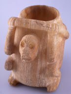 Effigy vessel with skeletal figure monkey figure