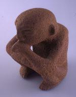 Figurine holding flute