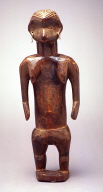 Female figure standing, concave heart-shaped face, tapering trunk and legsblue beads in eyes