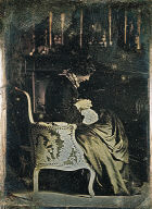 Interior with a woman sewing