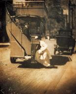 Woman boarding double-decker bus