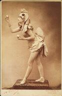 Dancer in costume holding eggs