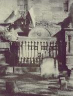 Linen on a Clothespole Flaps against Funeral Sculpture