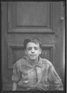 Portrait of Boy in Doorway