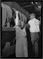 Two men Dyeing Yarn in Tall Vat