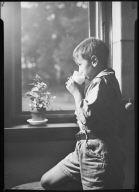 Portrait of a Child Drinking Milk