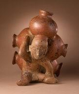Cargador (Seated Male Figure with Five Pots)