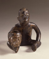 Seated Male Figure Holding Head Pot