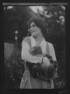 Savagoy, Henriette, with cat, outdoors