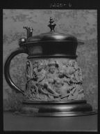 Beer stein decorated with relief carvings of mythological figures