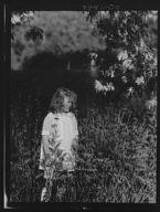 Dunning, Mr., daughter of, standing in a garden