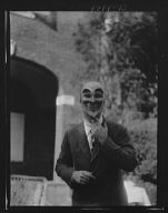 Person wearing a mask made by W.T. Benda