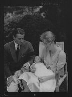 Brady, James Cox, Jr., Mr. and Mrs., and child, seated outdoors