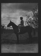Noland, Charlotte, Miss, on horseback