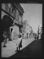 Street scene in an unknown country, possibly in Central America or Spain
