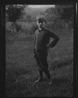 Unidentified child, standing outdoors