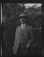 Unidentified man, standing outdoors