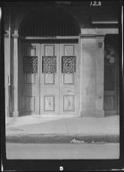 Door set in an arched passageway, New Orleans or Charleston, South Carolina