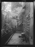 View down narrow outdoor passageway, New Orleans or Charleston, South Carolina