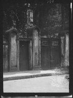 Gate and doorway set in free-standing wall, New Orleans or Charleston, South Carolina